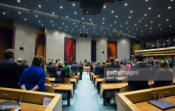 Members of the Dutch Parliament observe a minute of silence at the Parliament in The Hague on March 24 in tribute to the victims of the Brussel...