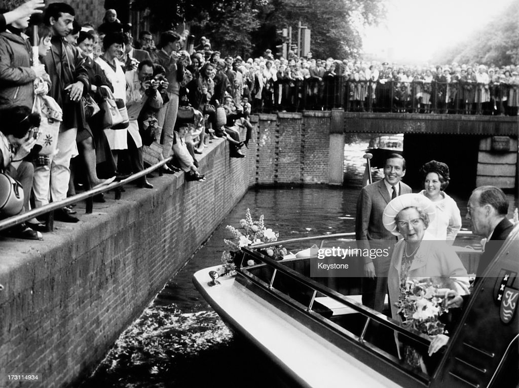 Members of the Dutch royal family on a barge during a visit to Amsterdam 3rd July 1965 Front Queen Juliana and Prince Bernhard Back Princess Beatrix...