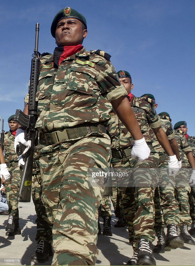 Members of the East Timorese security force parade at the presidential palace in Dili on May 20, 2010 during the independence day celebrations. East Timorese President Jose Ramos-Horta said his young country had finally achieved peace and could look forward to prosperity as it celebrated eight years of independence from Indonesia. The Nobel laureate Ramos-Horta added the former Portuguese colony, which was annexed by Indonesia in 1975, had at last turned a page on its violent past.