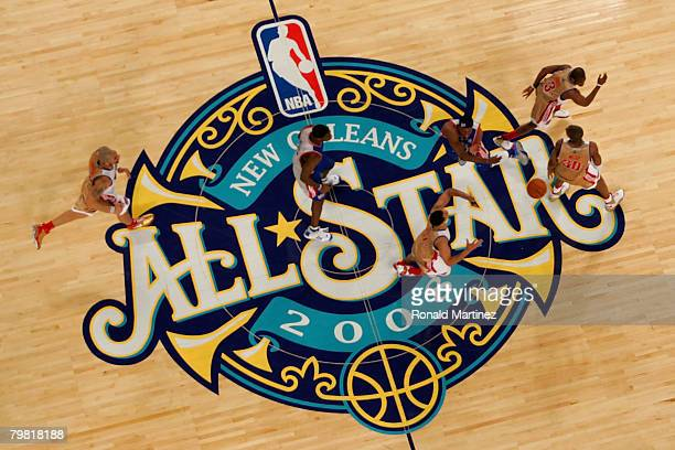 Members of the Eastern Conference and the Western Conference AllStar teams run across midcourt during the 57th NBA AllStar Game part of 2008 NBA...
