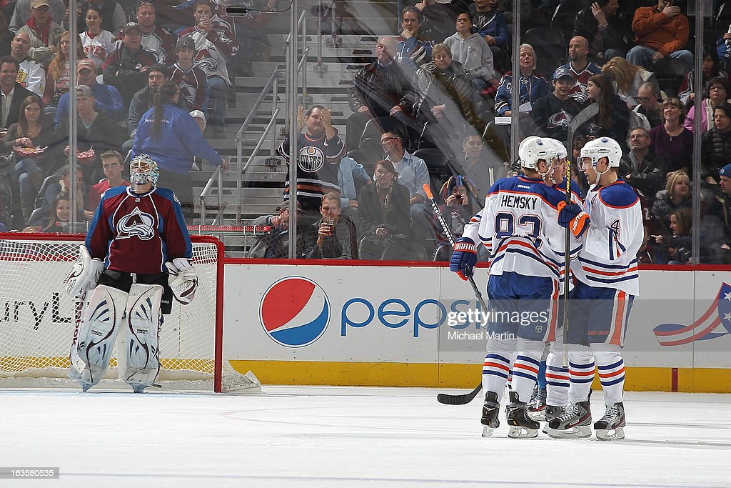 Members of the Edmonton Oilers celebrate a goal against the Colorado Avalanche at the Pepsi Center on March 12, 2013 in Denver, Colorado.