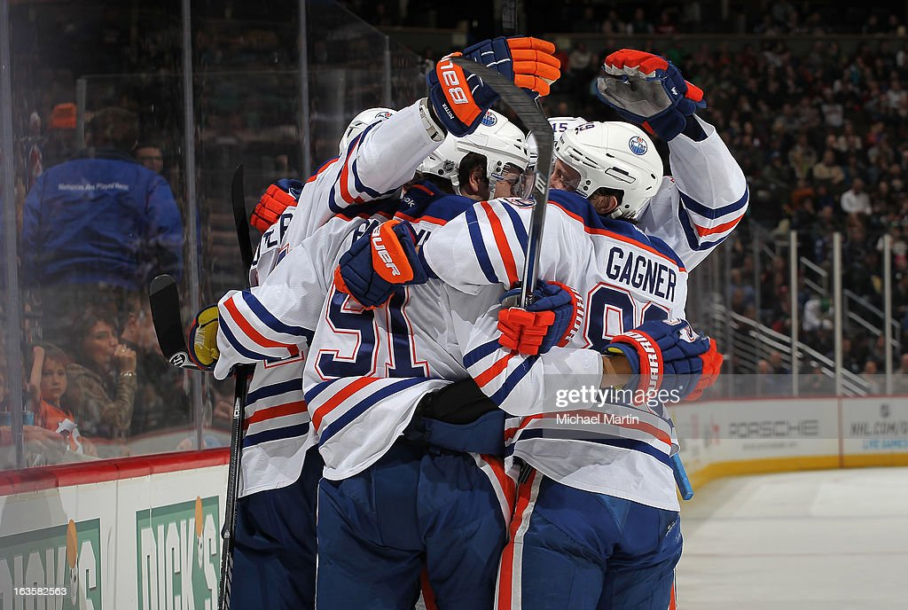 Members of the Edmonton Oilers celebrate a second period goal against the Colorado Avalanche at the Pepsi Center on March 12, 2013 in Denver, Colorado.