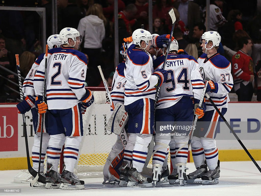 Members of the Edmonton Oilers celebrate a win over the Chicago Blackhawks at the United Center on March 10, 2013 in Chicago, Illinois. The Oilers defeated the Blackhawks 6-5.