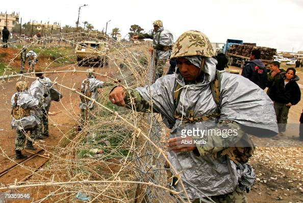 Members of the Egyptian border forces repair a section of the breached border wall between Egypt and Rafah January 29 2008 in Rafah the southern Gaza...