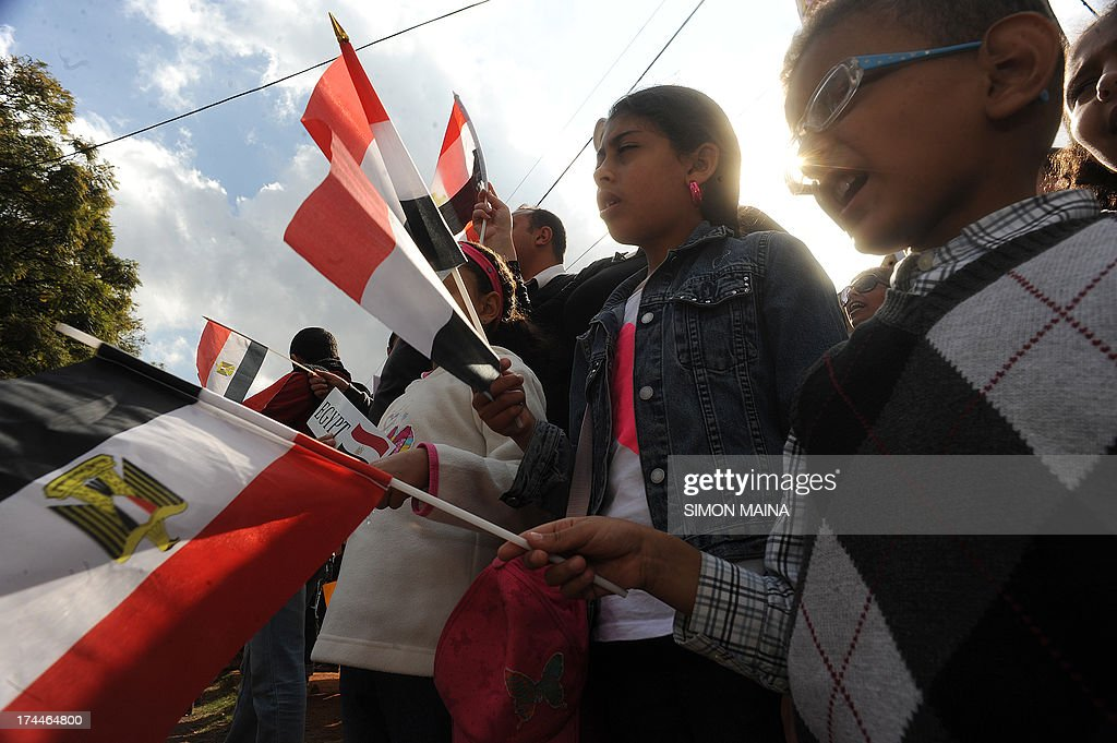 Members of the Egyptian community in Nairobi hold Egyptian flags and sing during a peaceful demonstration in support of 'military action against terrorism' in Egypt, on July 26, 2013 in front of the Egyptian Embassy premises. The mass action comes in response to the call by General Abdel Fatah El-Sisi, Egyptian minister of Defence,on July, requesting the Egyptian People to confirm and support the mandate of the military forces to take action against terrorism, violence and crime targeting civilians and national security.
