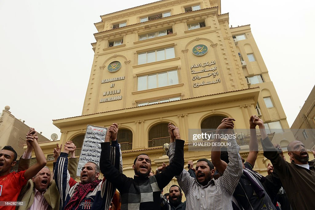 Members of the Egyptian Muslim brotherhood gather in front the party's headquarters in Cairo on March 22, 2013. A group of men stormed a Muslim Brotherhood office in the Egyptian capital, ransacking it and assaulting some of the group's members, the movement's spokesman told AFP. AFP PHOTO/KHALED DESOUKI