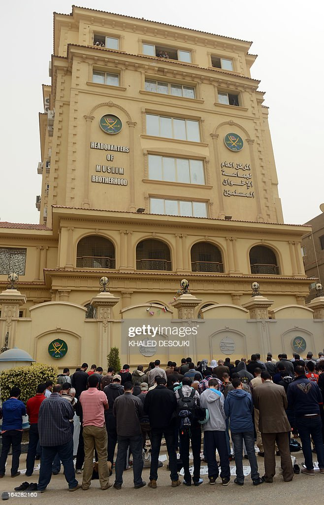 Members of the Egyptian Muslim brotherhood pray in front the party's headquarters in Cairo on March 22, 2013. A group of men stormed a Muslim Brotherhood office in the Egyptian capital, ransacking it and assaulting some of the group's members, the movement's spokesman told AFP. AFP PHOTO/KHALED DESOUKI