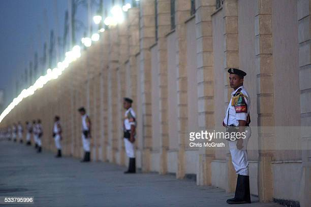 Members of the Egyptian police force stand guard outside the ElMosheer Tantawy Mosque ahead of the memorial ceremony held by EgyptAir for realtives...