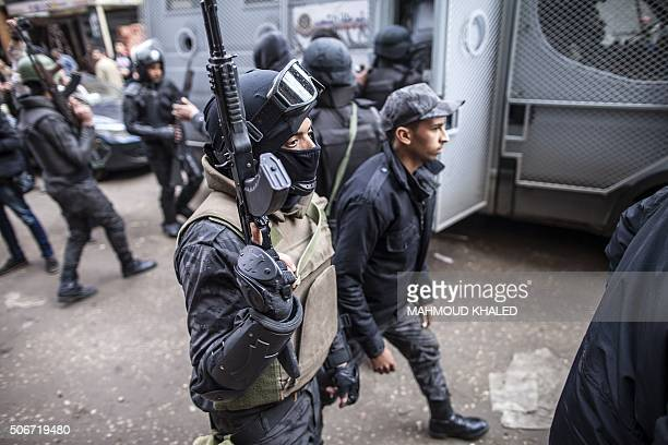 Members of the Egyptian police special forces patrol streets in alHaram neighbourhood in the southern Cairo Giza district on January 25 2016 in order...