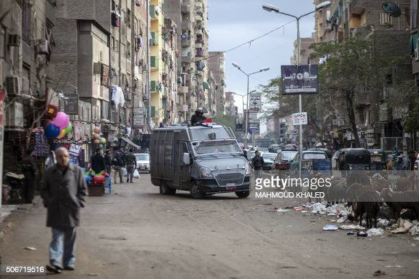 TOPSHOT Members of the Egyptian police special forces patrol streets in alHaram neighbourhood in the southern Cairo Giza district on January 25 2016...