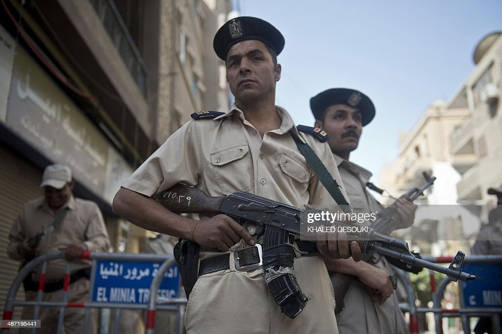 Members of the Egyptian security forces monitor the streets in the southern city of Minya on April 28 after a court sentenced 682 alleged Islamists...