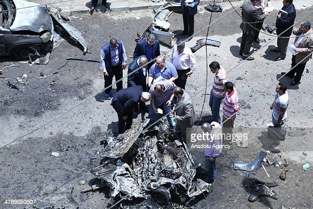Members of the Egyptian security services inspect the scene of a bombing targeting the convoy of the Egyptian Prosecutor General Hisham Barakat in a...