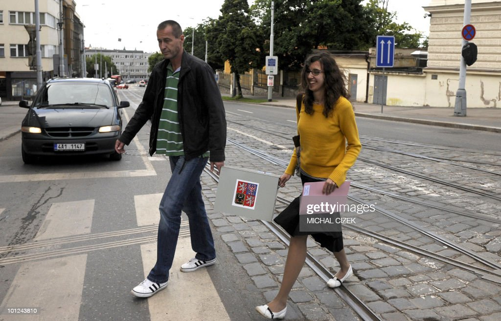 Members of the election committee carry a mobile polling box on May 28, 2010 in Prague during the first day of the Czech elections. Czechs started voting in a general election Friday to choose new leaders and bring an end to a political limbo triggered by the collapse of a centre-right coalition more than a year ago. PHOTO