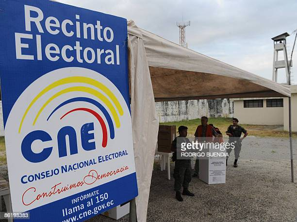 Members of the Electoral National Council and military guards prepares a poll centre before that inmates cast their vote at the Litoral prison in...