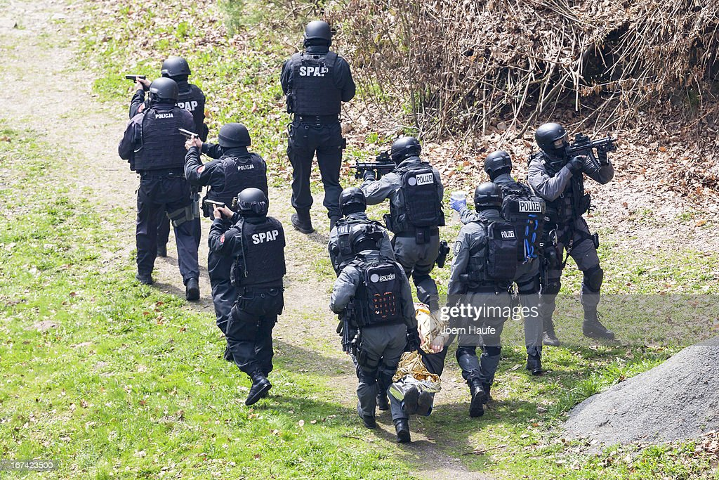 Members of the elite German national SEK police special forces and their Polish counterparts, the SPAP, demonstrate capabilities by foiling a staged border kidnapping during a presentation to the media on April 25, 2013 at Lesna near Luban, Poland. The two units have trained together in a project sponsored by the European Union to improve cross-border police anti-terrorism law enforcement.