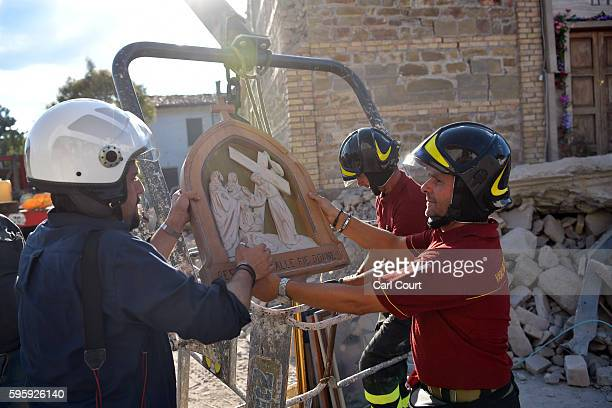 Members of the emergency services remove salvaged artefacts from a damaged church on August 26 2016 in San Lorenzo a Flaviano Italy Italy has...