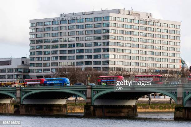 Members of the emergency services work between stationary London busses on Westminster Bridge near St Thomas' Hospital adjacent to the Houses of...