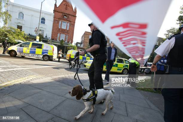 Members of the emergency services work near Parsons Green underground tube station in west London on September 15 following an incident on an...