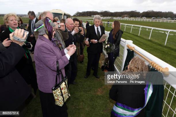 Members of the Emily Wilding Davison Working Group during the unveiling of a plaque for suffragette Emily Davison at Tattenham Corner at Epsom Downs...