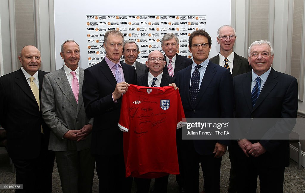 Members of the England 1966 Squad, (L-R) <a gi-track='captionPersonalityLinkClicked' href=/galleries/search?phrase=George+Cohen&family=editorial&specificpeople=703599 ng-click='$event.stopPropagation()'>George Cohen</a>, <a gi-track='captionPersonalityLinkClicked' href=/galleries/search?phrase=Gerry+Byrne+-+Soccer+Player&family=editorial&specificpeople=15238868 ng-click='$event.stopPropagation()'>Gerry Byrne</a>, Sir <a gi-track='captionPersonalityLinkClicked' href=/galleries/search?phrase=Geoff+Hurst&family=editorial&specificpeople=206880 ng-click='$event.stopPropagation()'>Geoff Hurst</a>, <a gi-track='captionPersonalityLinkClicked' href=/galleries/search?phrase=Gordon+Banks&family=editorial&specificpeople=215465 ng-click='$event.stopPropagation()'>Gordon Banks</a>, <a gi-track='captionPersonalityLinkClicked' href=/galleries/search?phrase=Nobby+Stiles&family=editorial&specificpeople=220308 ng-click='$event.stopPropagation()'>Nobby Stiles</a>, <a gi-track='captionPersonalityLinkClicked' href=/galleries/search?phrase=Martin+Peters&family=editorial&specificpeople=643328 ng-click='$event.stopPropagation()'>Martin Peters</a>, <a gi-track='captionPersonalityLinkClicked' href=/galleries/search?phrase=Jack+Charlton&family=editorial&specificpeople=453447 ng-click='$event.stopPropagation()'>Jack Charlton</a> and Ian Callaghan wish <a gi-track='captionPersonalityLinkClicked' href=/galleries/search?phrase=Fabio+Capello&family=editorial&specificpeople=241290 ng-click='$event.stopPropagation()'>Fabio Capello</a> (3rd R) manager of England good luck at next month's World Cup with a signed shirt at the Grand Connaught Rooms on May 13, 2010 in London, England.