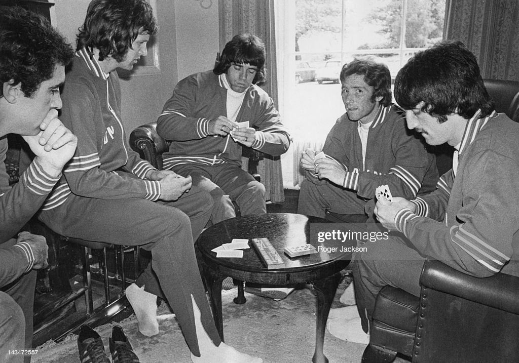 Members of the England football squad playing cards at the team headquarters in Hertfordshire, 23rd May 1975. Left to right: <a gi-track='captionPersonalityLinkClicked' href=/galleries/search?phrase=Peter+Shilton&family=editorial&specificpeople=233478 ng-click='$event.stopPropagation()'>Peter Shilton</a>, Mick Channon, <a gi-track='captionPersonalityLinkClicked' href=/galleries/search?phrase=Kevin+Keegan&family=editorial&specificpeople=206359 ng-click='$event.stopPropagation()'>Kevin Keegan</a>, Alan Ball and David Johnson.