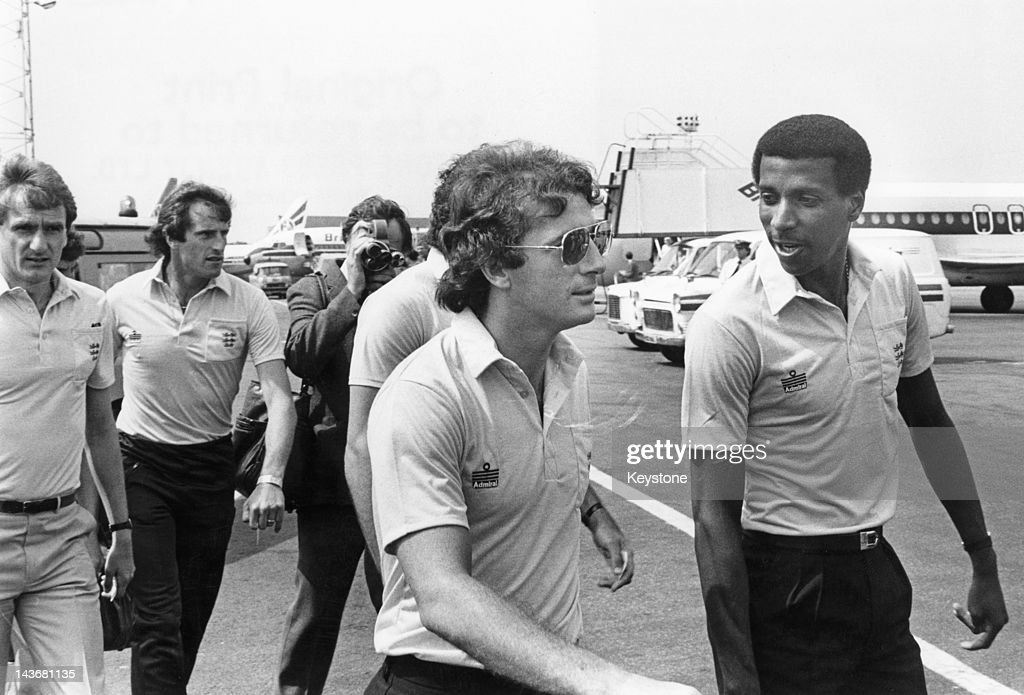 Members of the England football team at an airport, 1982. Left to right: Phil Thompson, Ray Clemence, Trevor Francis and Viv Anderson.