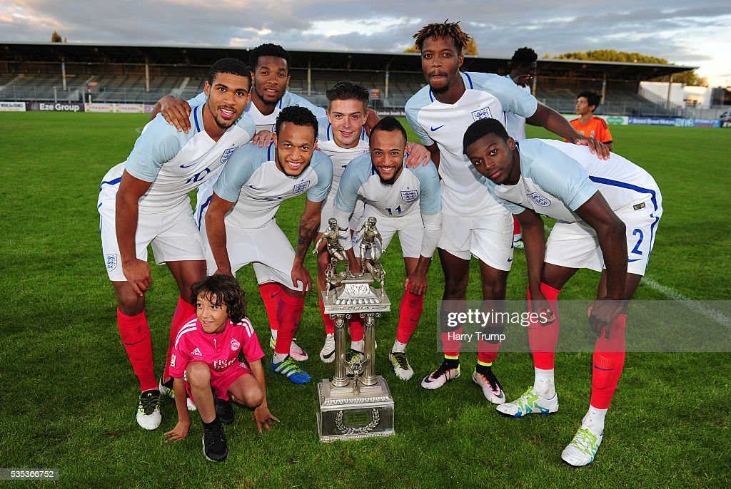 Members of the England side celebrate with the trophy during the Final of the Toulon Tournament between England and France at Parc Des Sports on May 29, 2016 in Avignon, France.
