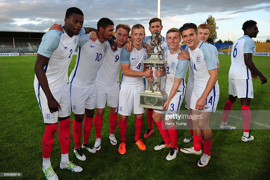 Members of the England side pose with the trophy during the Final of the Toulon Tournament between England and France at Parc Des Sports on May 29, 2016 in Avignon, France.