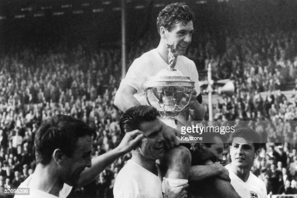 Members of the England team carry their captain Johnny Haynes around Wembley Stadium after beating Scotland 93 in the Soccer International 15th April...