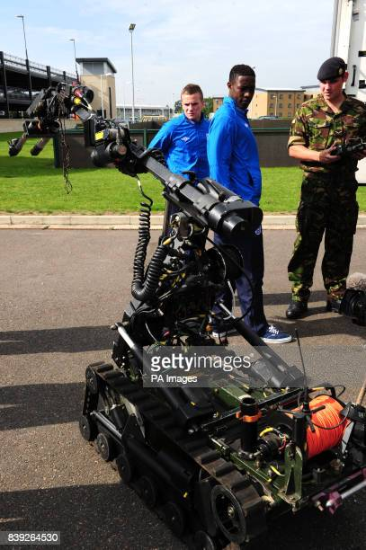 Members of the England U21 squad are shown a bomb disposal robot during a tour of 16 Air Assault Brigade and Colchester Garrison Colchester