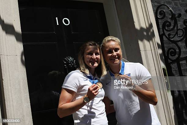 Members of the England Women's Football team Ellen White and Steph Houghton take pictures outside 10 Downing Street on July 9 2015 in London England...