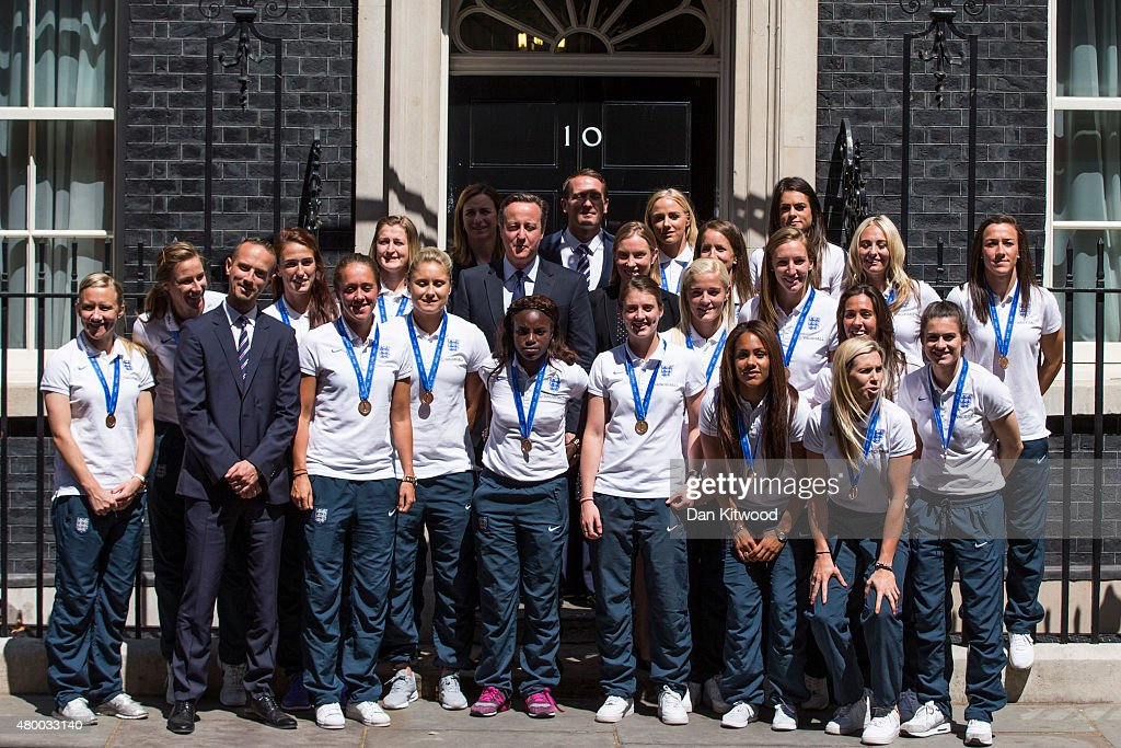 Members of the England Women's Football team pose with British Prime Minister David Cameron outside 10 Downing Street on July 9, 2015 in London, England. The team met the British Prime Minister David Cameron, and earlier met HRH Prince William after returning home from their World Cup campaign where they came third.
