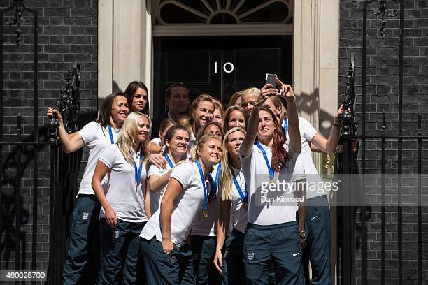 Members of the England Women's Football team take a 'selfie' outside 10 Downing Street on July 9 2015 in London England The team met the British...