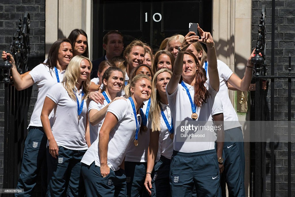 Members of the England Women's Football team take a 'selfie' outside 10 Downing Street on July 9, 2015 in London, England. The team met the British Prime Minister David Cameron.