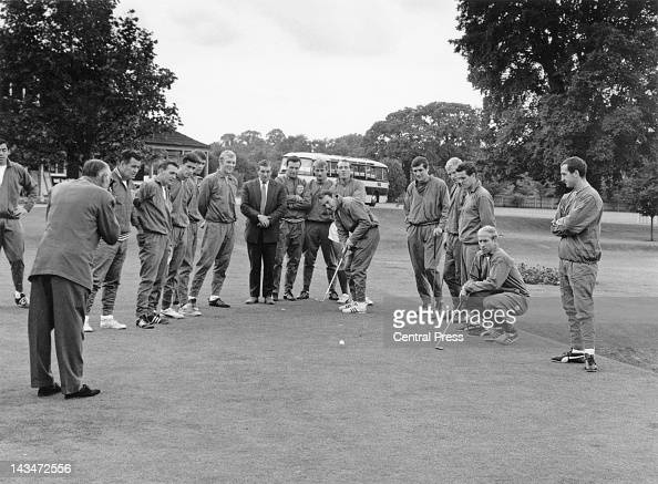 Members of the England World Cup squad playing golf during a break in training at Roehampton London the day before their World Cup final match...