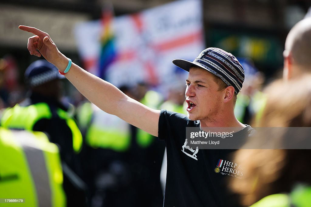 Members of the English Defence League arrive at a rally at Aldgate on September 7, 2013 in London, England. The EDL far-right organisation have had restrictions placed on the march by the Metropolitan police due to the fear of 'serious public disorder', but it will still proceed to the edge of Tower Hamlets, which is home to a large population of ethnic minorities.