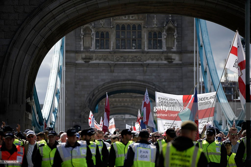 Members of the English Defence League cross Tower Bridge on their way to a rally at Aldgate on September 7, 2013 in London, England. The EDL far-right organisation have had restrictions placed on the march by the Metropolitan police due to the fear of 'serious public disorder', but it will still proceed to the edge of Tower Hamlets, which is home to a large population of ethnic minorities.