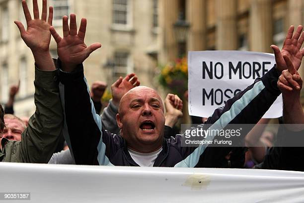 Members of the English Defence League hold make shift signs as they shout towards Police and antiright wing protesters during a rally on September 5...