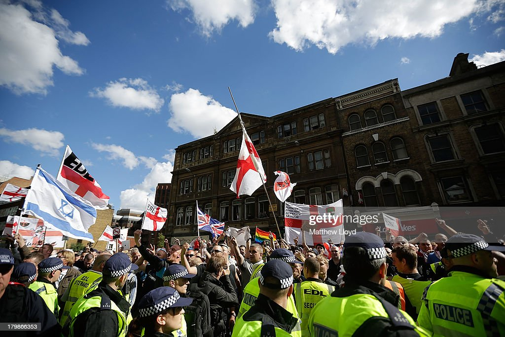 Members of the English Defence League, rally for speeches by the far-right organisation's leader and deputy leader at Aldgate on September 7, 2013 in London, England. The EDL far-right organisation have had restrictions placed on the march by the Metropolitan police due to the fear of 'serious public disorder', but it will still proceed to the edge of Tower Hamlets, which is home to a large population of ethnic minorities.