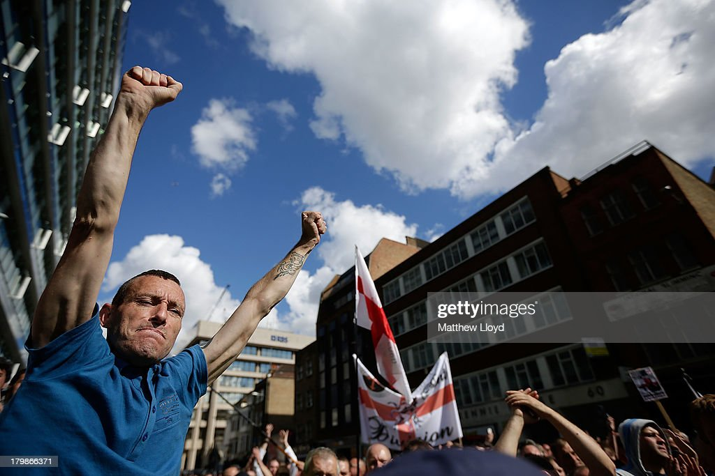 Members of the English Defence League rally for speeches by the far-right organisation's leader and deputy leader at Aldgate on September 7, 2013 in London, England. The EDL far-right organisation have had restrictions placed on the march by the Metropolitan police due to the fear of 'serious public disorder', but it will still proceed to the edge of Tower Hamlets, which is home to a large population of ethnic minorities.