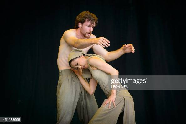 Members of the English National Ballet perform 'Dust' choreographed by Akram Khan from 'Lest We Forget' on the Pyramid Stage on the last day of the...