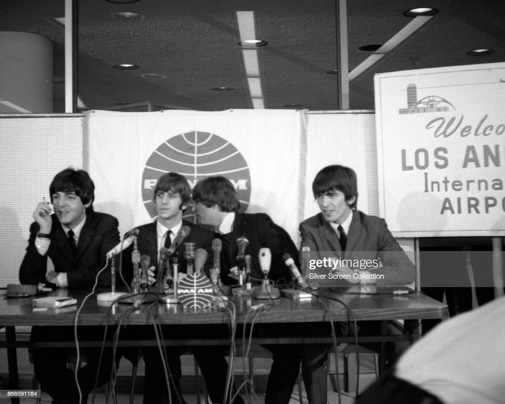Members of the English Pop group the Beatles answer questions during a press conference at Los Angeles International Airport, Los Angeles, California, August 18, 1964. Pictured are, from left, Paul McCartney, Ringo Starr, John Lennon (1940 - 1980), and George Harrison (1943 - 2001). They were at the airport during a stopover on the way to San Francisco for the first concert of their first, extended American tour (though they had played several US concerts earlier in the year, including three appearances on the Ed Sullivan Show).