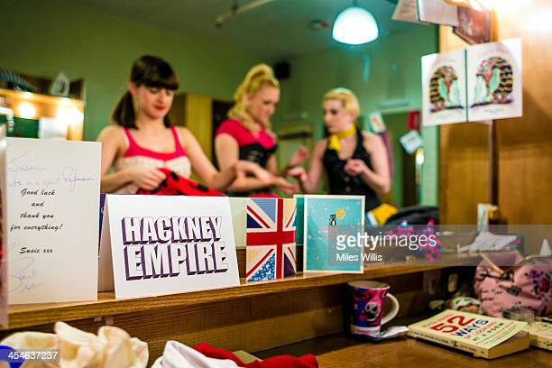 Members of the ensemble prepare in their dressing room prior to the Puss in Boots pantomime at the Hackney Empire on December 6 2013 in London England