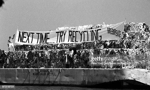 Members of the environmental group Greenpeace display banner saying 'Next TimeTry Recycling' aboard Mobro garbage barge in Gravesend Bay yesterday...