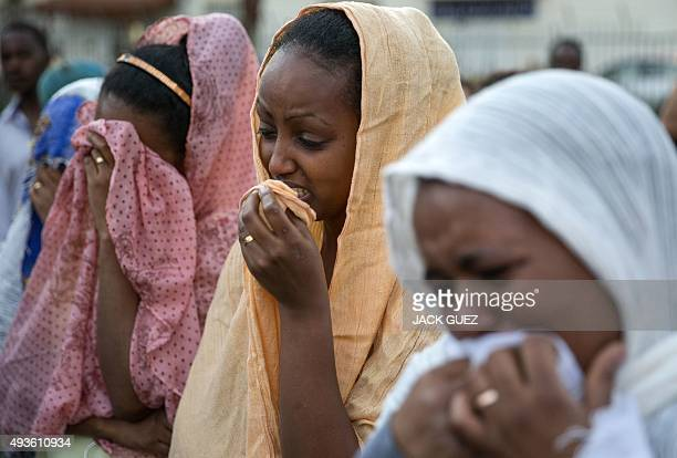 Members of the Eritrean community in Israel mourn on October 21 2015 in the Israeli city of Tel Aviv during a memorial ceremony for Eritrean asylum...