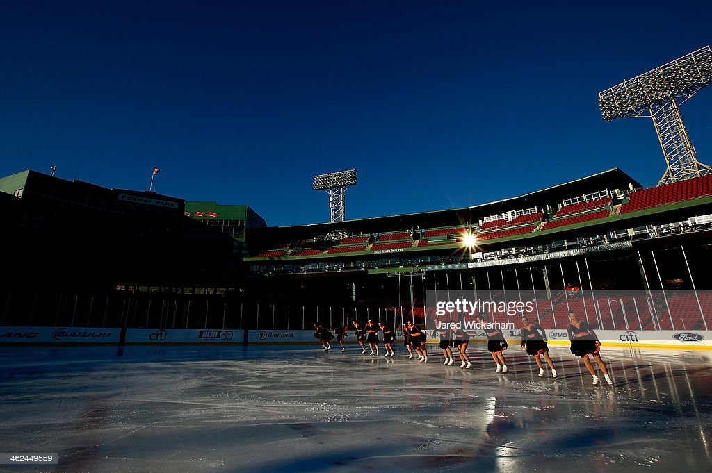 Members of the Espirit De Corps synchronized skating team perform their routine during the figure skating show as part of the Citi Frozen Fenway events at Fenway Park on January 13, 2014 in Boston, Massachusetts.