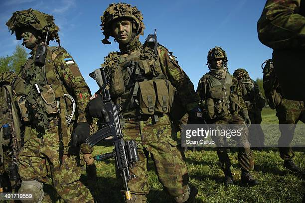 Members of the Estonian Scouts Battalion which served in Afghanistan participate in the NATO 'Spring Storm' military exercises on May 17 2014 near...