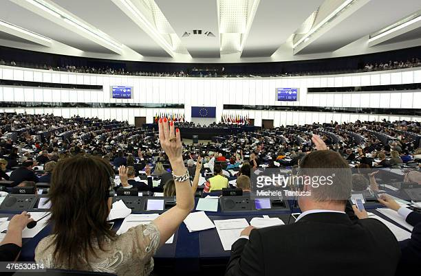 Members of the European Parliament vote during a plenary session on June 10 2015 in Strasbourg France The EU Parliament decided to postpone the...