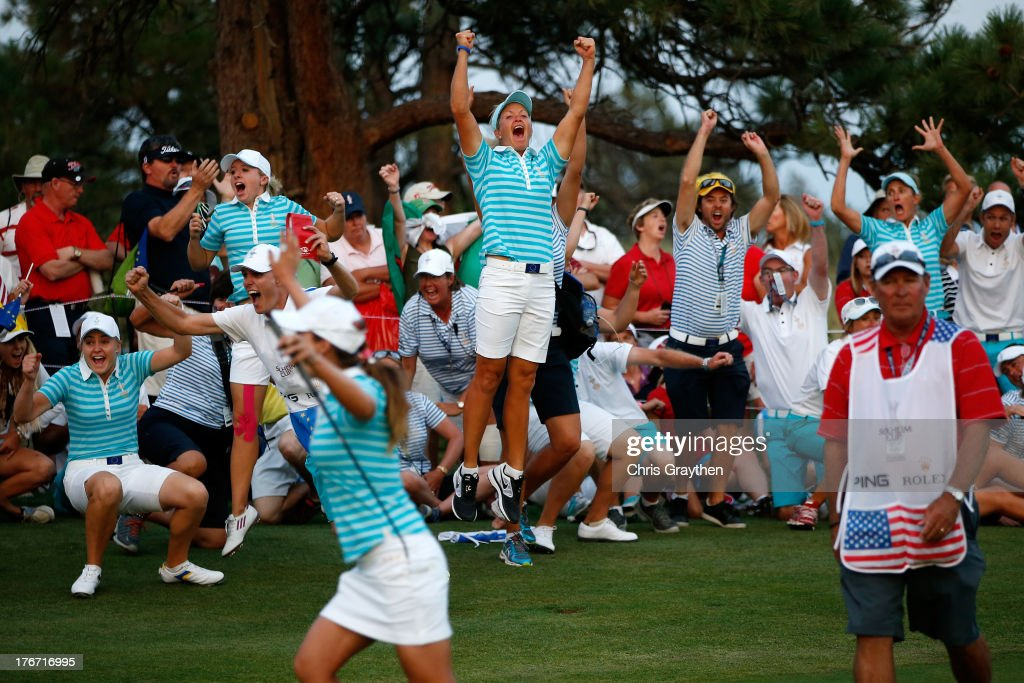 Members of the European Team celebrate after Karine Icher of France made a putt on the 18th hole to win their match by one hole during the afternoon Four-Ball matches for the 2013 Solheim Cup on August 17, 2013 at The Colorado Golf Club in Parker, Colorado.