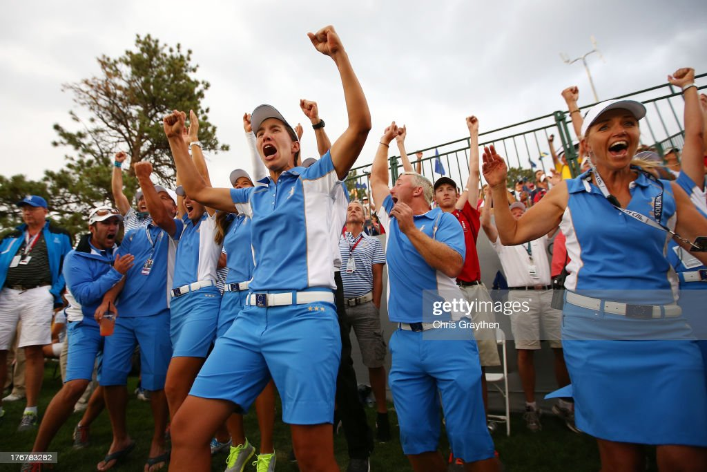 Members of the European Team celebrate as they retain the Solheim Cup during the final day singles matches of the 2013 Solheim Cup on August 18, 2013 at The Colorado Golf Club in Parker, Colorado.
